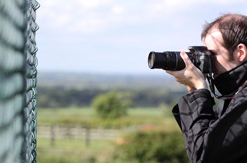 man with long lens camera